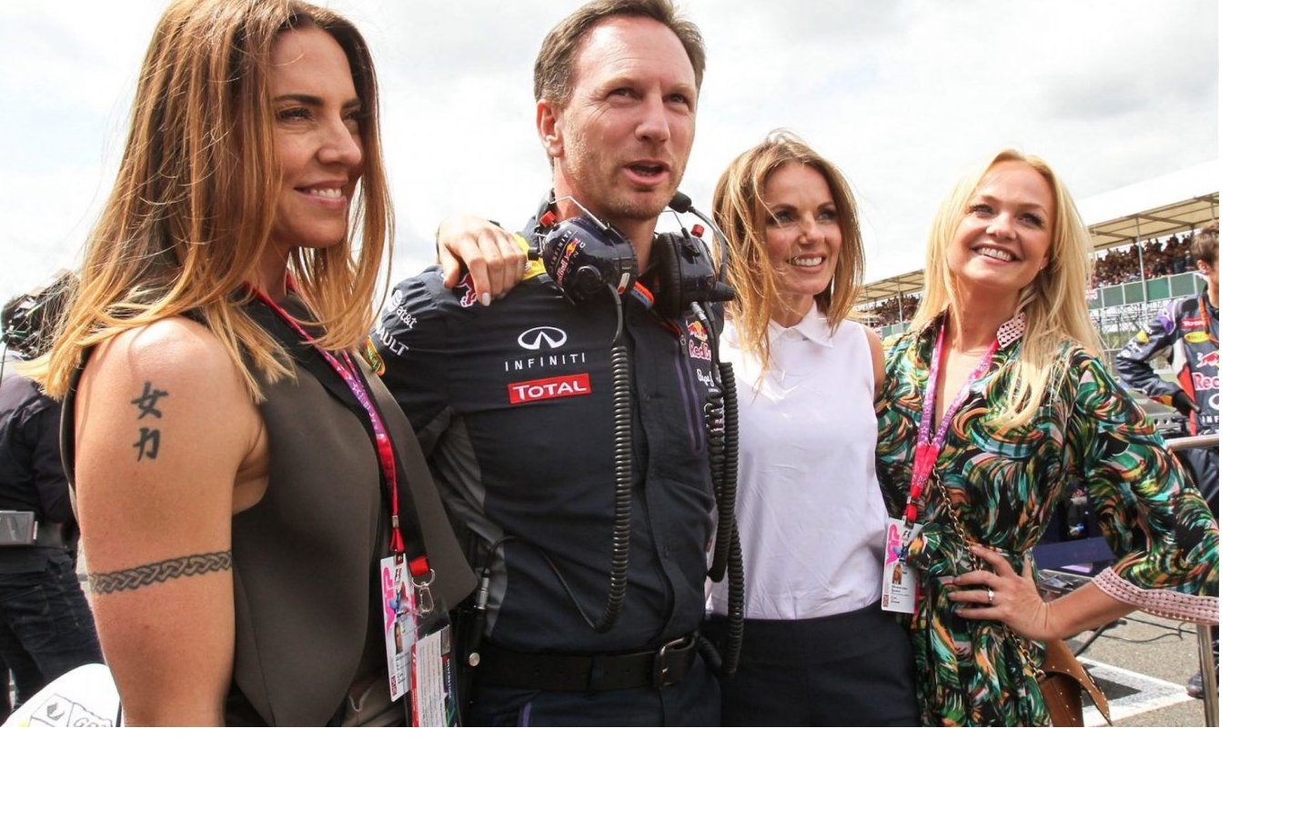 Spice Girls singer Mel C, Christian Horner of Red Bull Racing Team with wife Geri Halliwell and Emma Bunton on the grid at the British Grand Prix in Silverstone, England, July 2015
